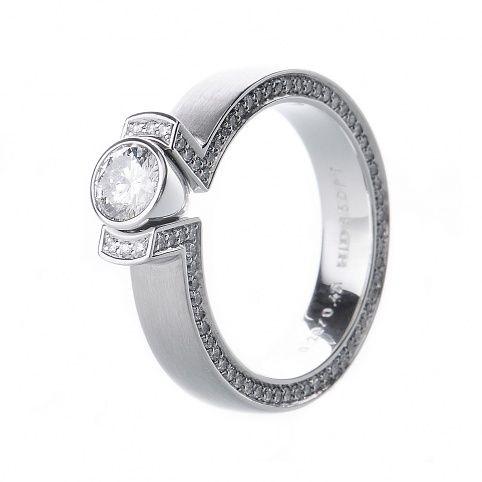 Stuart Moore platinum solitaire engagement ring set with a 0.47ct round brilliant cut diamonds, set with 69 round brilliant cut diamonds