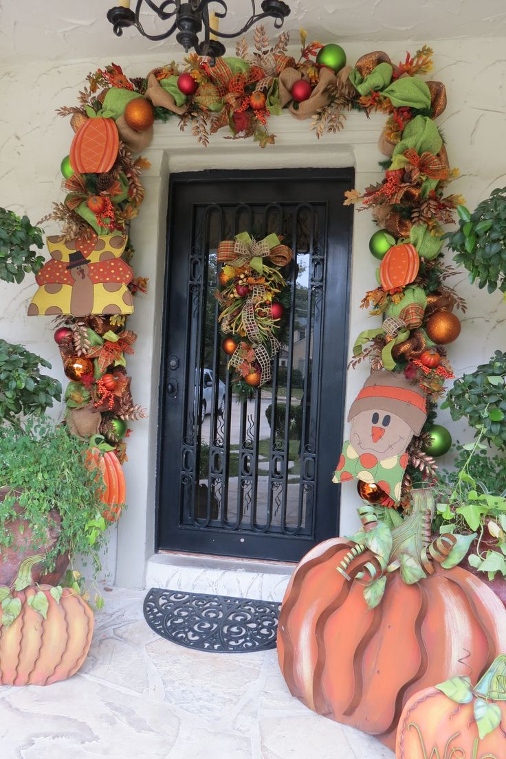 198 best doorways by show me decorating images on pinterest 2015 halloween diy snowman and pumpkin deco mesh door garland door decor
