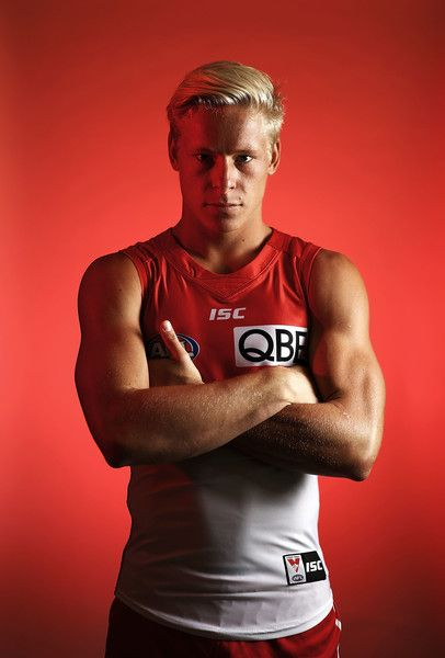 Isaac Heeney Photos Photos - Isaac Heeney of the Swans poses during a portrait session at the SCG on February 14, 2017 in Sydney, Australia. - Sydney Swans Portrait Session