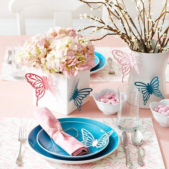Pretty Spring Table Setting  This pastel pink-and-blue color scheme is perfect for a pretty Easter table setting. To achieve this look, accent vases and place settings with paper butterflies (find similar ones at crafts or scrapbooking stores) or other symbols that represent spring, such as birds or eggs. Fill small dishes with pink jelly beans and arrange pink napkins on blue plates. Pink hydrangea in a square vase makes for a great centerpiece