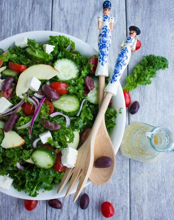 Healthy Kale Greek Salad : Swap your average salad with this healthy kale Greek salad recipe. Loaded up with extra fibre, iron and protein and an extra shot of flavor from the kale . A little bitterness which is perfectly balanced by sweet apples, a delicate saltiness from the feta and Kalamata olives, all tossed with tomatoes, cucumbers, red onions and fresh oregano leaves.