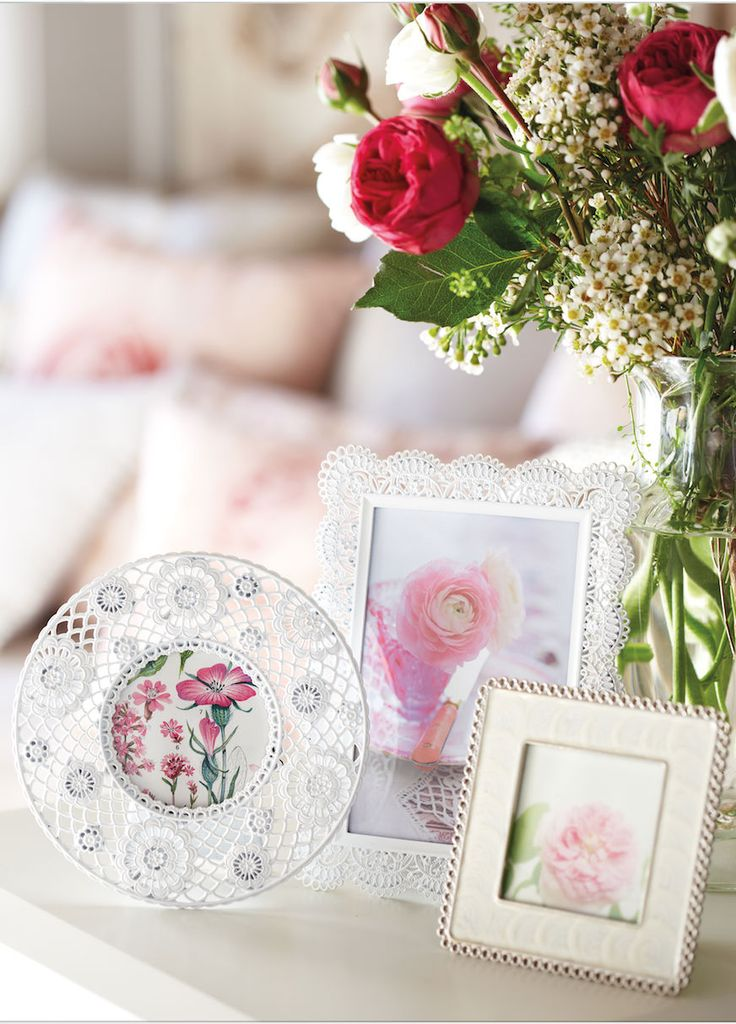 Spruce up your bedside table with flowers and vintage style photo frames