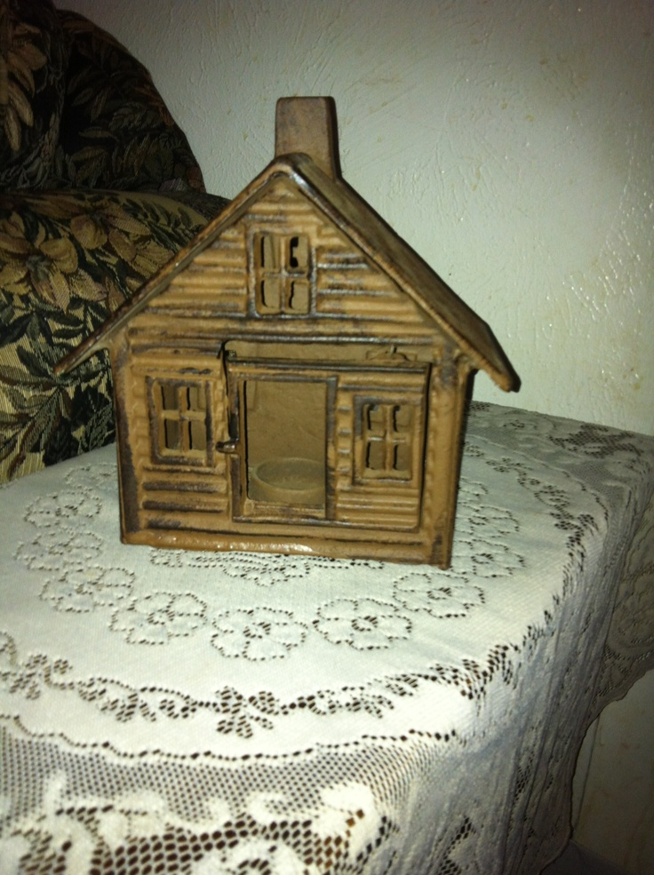 """When my seven years old granddaughter Brynna saw this little iron cabin tea light holder in an antique mall she exclaimed, """" Look Mawmaw! It's Little House In The Big Woods! You need to buy it!"""". So I did."""