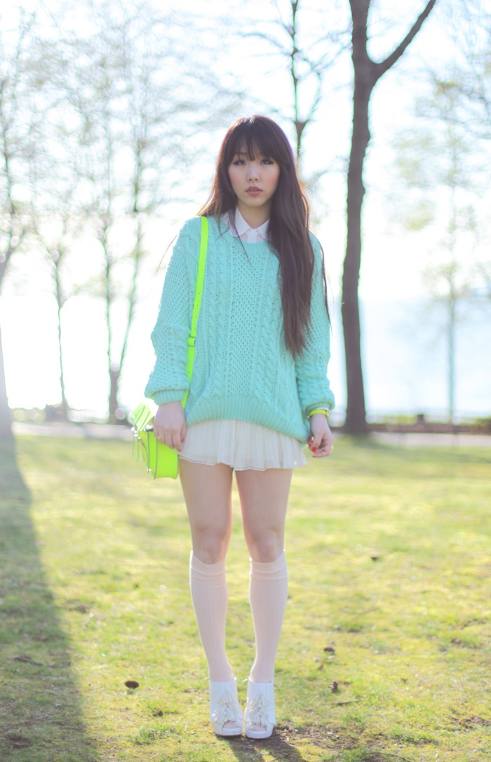 Clear pink over knee socks, white pumps, light short pleated skirt, blue lagoon knitted pullover