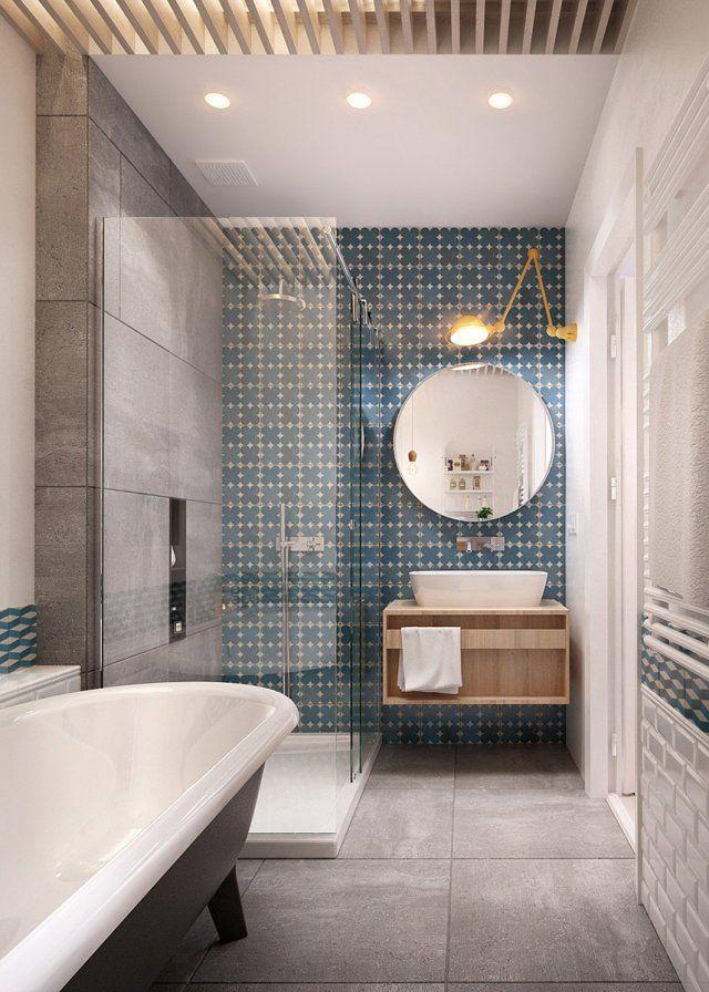 """<p>Cette salle de bain fait cohabiter avec beaucoup de gout un certain nombre d'éléments différents. Ainsi le béton, le carrelage """"métro"""" style 1900, le bois et la..."""
