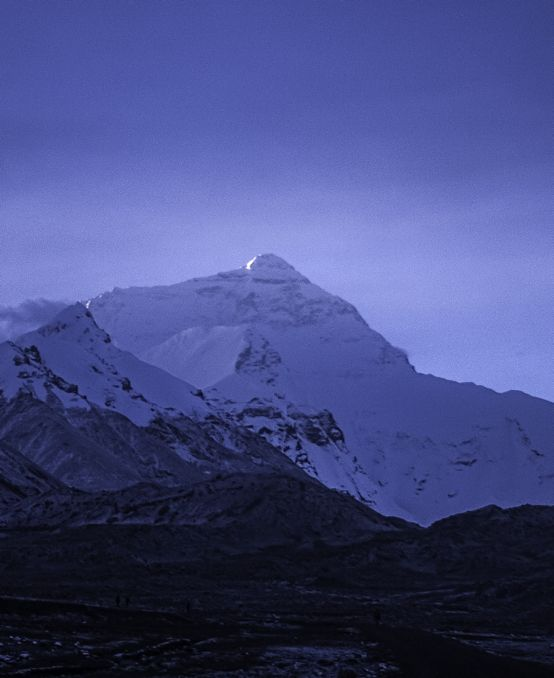 The Goddess awakens as the first rays of sun hit the peak of Mount Everest. The Tibetan name for the mountain is Qomolangma, which means Goddess.