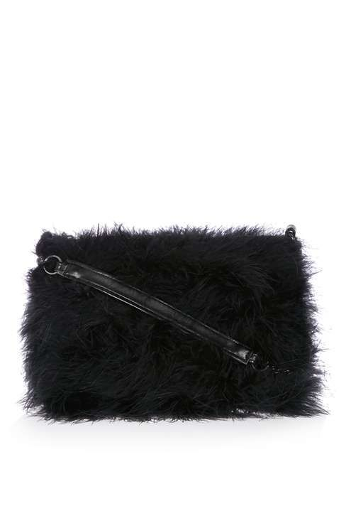 Look to fluffy details to refresh your accessories with this black cross body bag, finished in feather detail and featuring a long silver chain strap. 100% Turkey feathers. #Topshop