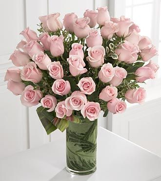 They've guided you through every pivotal moment in your life. Your only wish is to create as much pleasure as they have continually done throughout the years. Offer them a bouquet of 48 stems of our pale pink long-stemmed roses situated in a superior cylindrical vase to create a moment of delight and blushing radiance they will never forget.