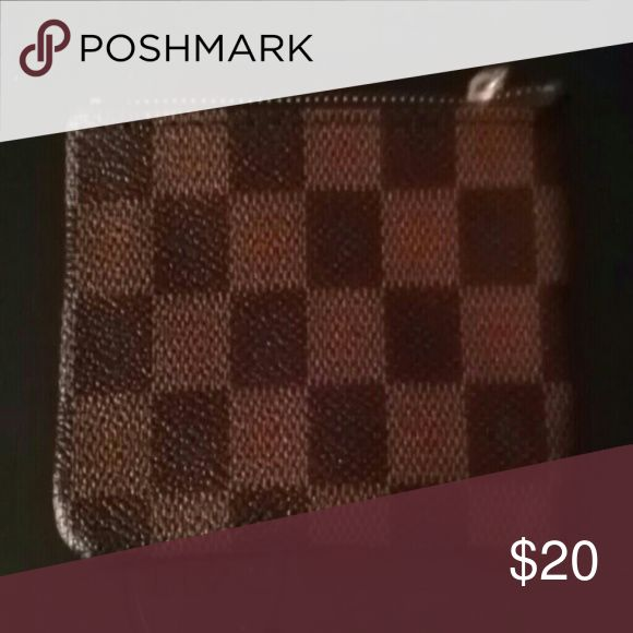 Brown checkered coin purse New Never worn It's just a checkered coin purse. There isn't any name on it Bags Wallets