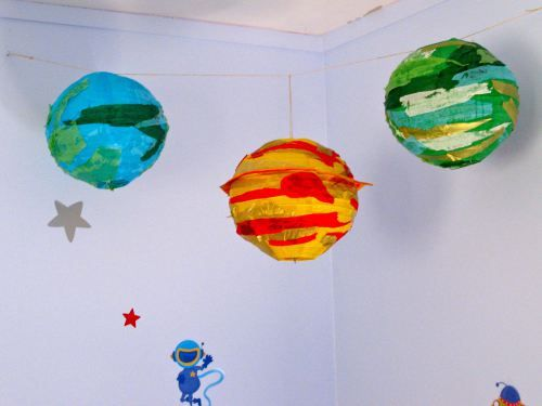 Paper-lantern planets (I love this idea.  I think it would be cool to make planets for reception decorations, although I am thinking more paint, less tissue).
