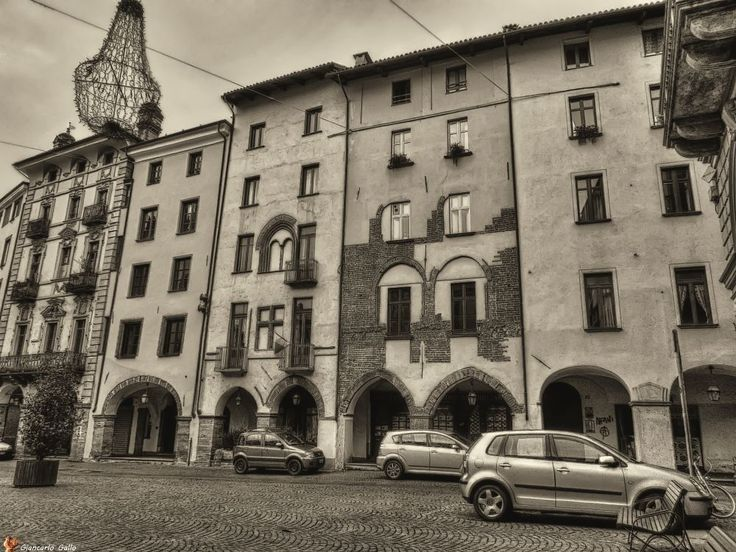 Parking in the medieval square by Giancarlo Gallo