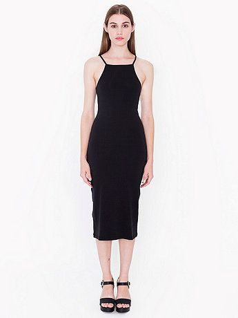 A sleeveless mid-length dress with spaghetti straps, high neckline and slightly ribbed construction.