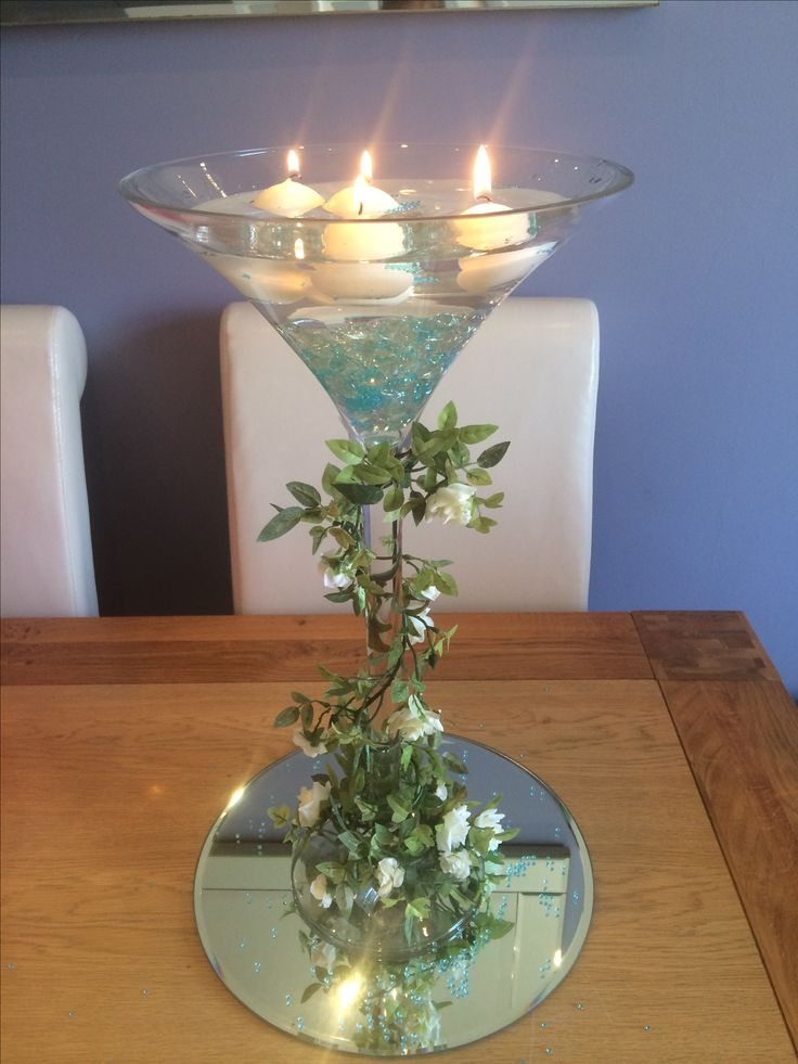Tall wedding centrepiece martini glass hire from