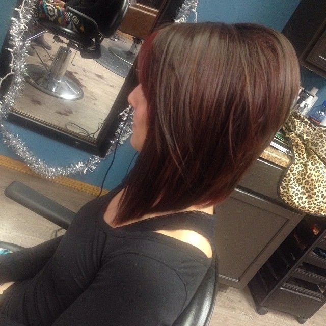 Drastic diagonal forward bob with a lot of fun layers throughout for extra body and texture!