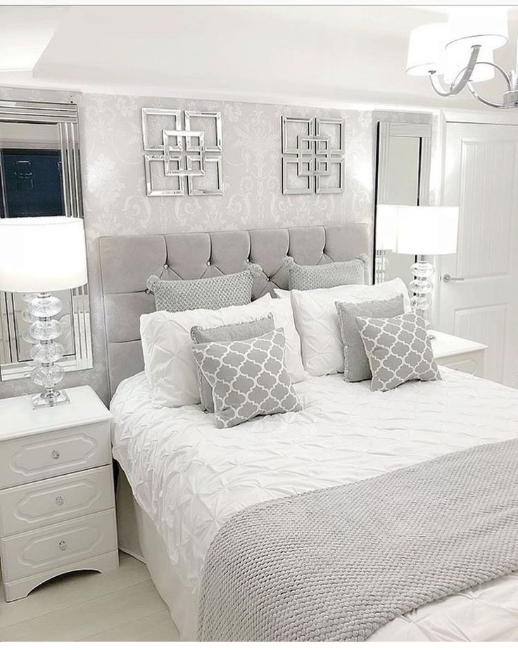 Love the matching mirrors above the matching night stands