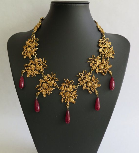 Truly stunning vintage Kenzo collier necklace. Gold tone metal floral design with amber resin beads, sunflower toggle closure & Kenzo Paris plaque on verso. Incomparable couture quality costume jewellery by a famous French fashion house. Excellent vintage condition.  Aprox Measurements Length: 21 / 54cm Medallions: 2 x 1.5