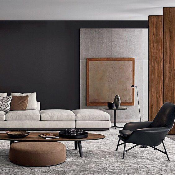 Minimal and sleek / dark walls, light couch