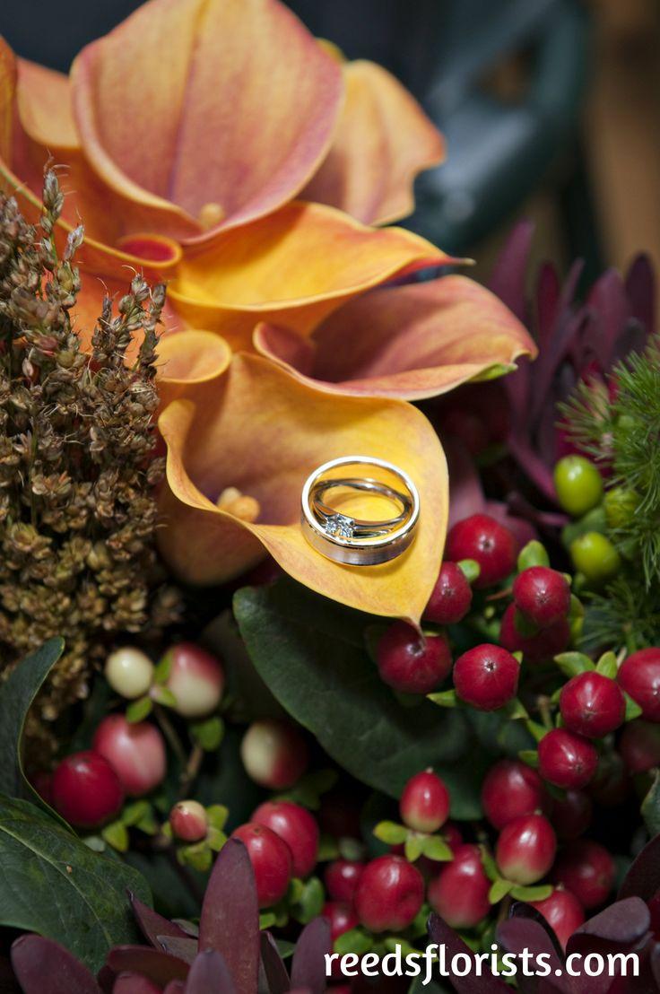 Beautiful Calla Lilies present the wedding rings.