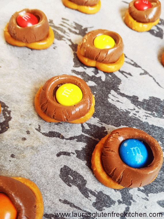 M&M Rolo Pretzel Bites ---Mini Gluten Free Pretzels, Caramel Rolos and M&Ms make up these wonderful, delicious treats. If you love sweet and salty combinations then these M&M Rolo Pretzel Bites are for you.