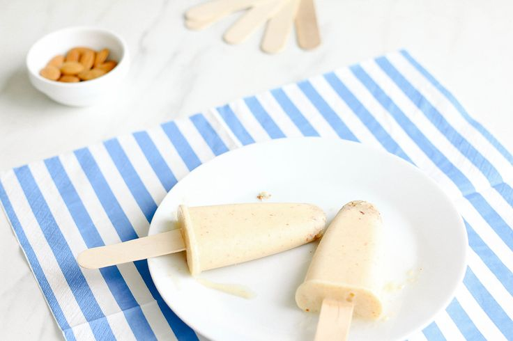 Eating a cold summer treat on a hot summer day is pretty much a necessity, right?! But those treats can often pack serious calories and lots of unhealthy ingredients, that's why it's always good to have a few healthy alternatives in your freezer just in case there's a record-breaking heat wave ... These yogurt peach pops are refreshing, healthy and each pop only has 100 calories. They're the perfect go-to snack for cooling off on a hot day.
