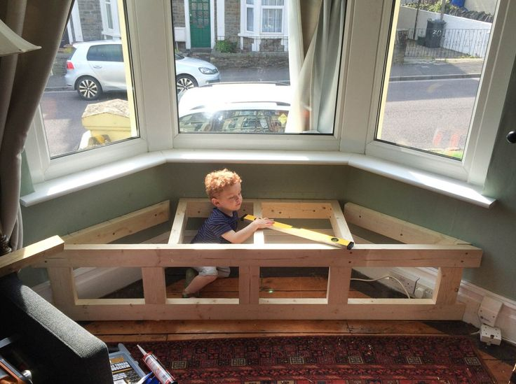 Steps for how to build a bay window seat with storage. Basic frame.