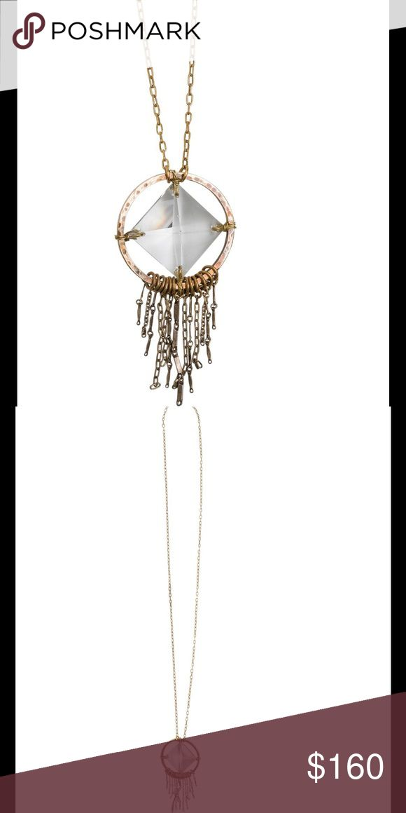 Free People Tribe Prism Fringe Crystal necklace Sold out Free People by Tribe Prism Fringe necklace. Vintage chandelier crystal hangs withing a hammered bronze ring. Fringe of chain hangs below. Bronze rings pendant is 2 inches in diameter. Gold plated bronze chain. Lobster clasp closure. Total chain length: 33 inches. Neck drop: 16 inches. Designed by Tribe for the Free People boutique collection Free People Jewelry Necklaces