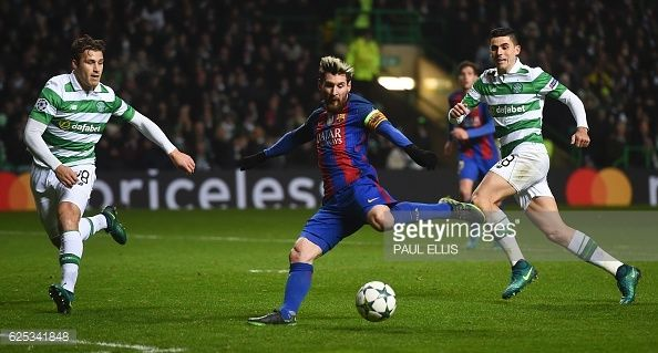 TOPSHOT Barcelona's Argentinian striker Lionel Messi shoots to score the opening goal during the UEFA Champions League group C football match between...