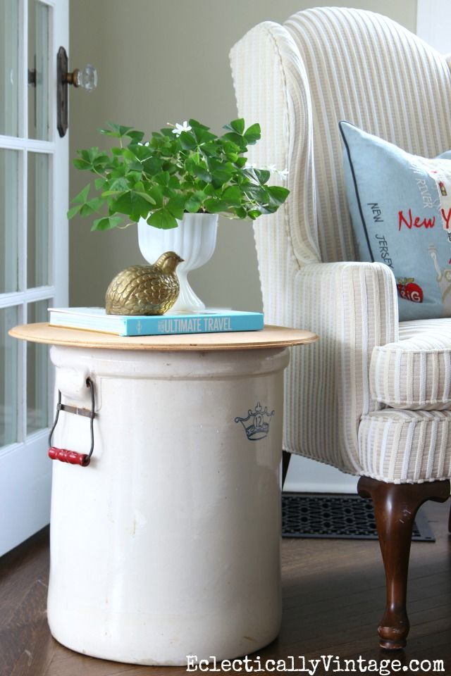 Vintage Crock Table - fun way to repurpose and old find. Add a piece of round wood and top with a few accessories like a book and plant for a cozy reading area. I love the New York embroidered pillow from HomeGoods eclecticallyvintage.com sponsored pin