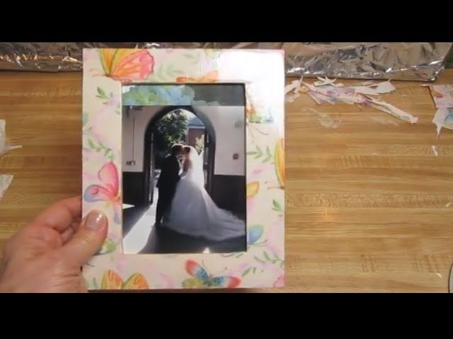 We are going to decoupage a picture frame. We'll use a wooden frame from the craft store, decoupage glue, sponge brushes, scissors, a top coat, and a piece of wrapping paper. That's it!        https://www.youtube.com/watch?v=63eYGfzKtbM