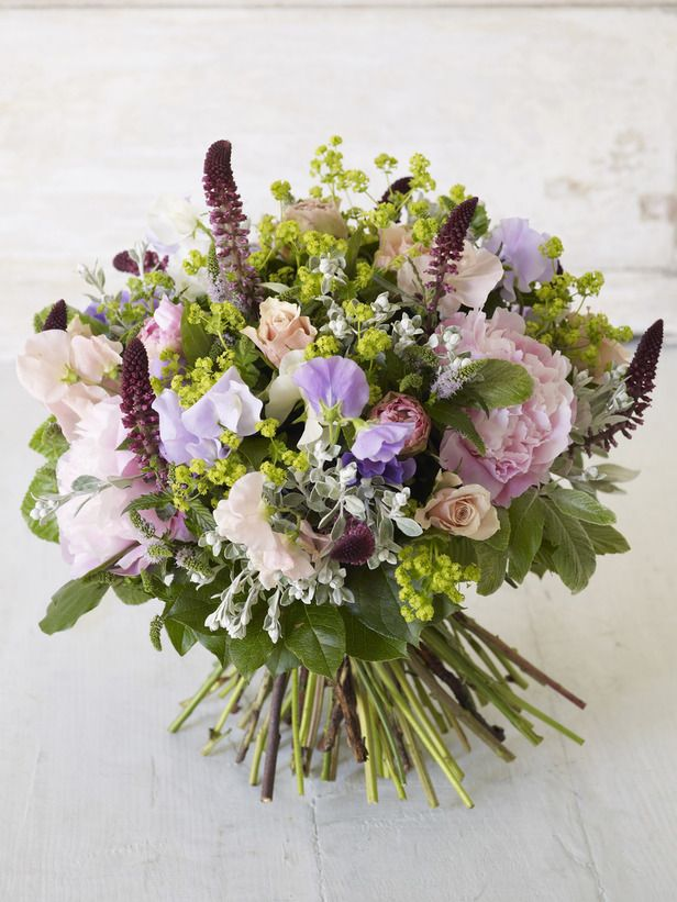 5 spearmint stems with flowers  10 alchemilla  8 single salmon pink roses  8-9 lysimachia  5 pale pink peonies  5 salal stems  5 senecio stems  10 mixed sweet peas