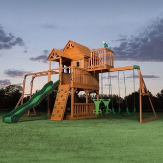 This outdoor playset will be the kids' favorite, with its raised clubhouse play fort, wooden roof, gabled entry way, and balcony. From the crow's nest, your kids can look out onto the horizon, then th