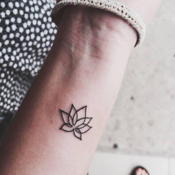 Little wrist tattoo of a lotus flower on Amina.