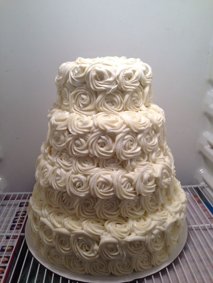 White rosette cake. 4 tier with cream cheese frosting.