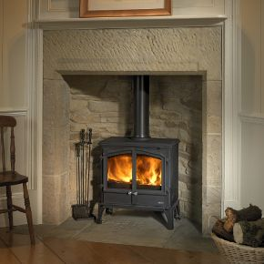 Esse 100 DD Stove - 100 DD. Engineered from cast iron and high grade steel and featuring Afterburn TM our precision secondary air control system, the 100 double door offers the country look with modern stove performance. 100 DD boasts a 5kW output with wide view, slim profile and it has been independently certified for use with a 12mm non-combustible hearth.