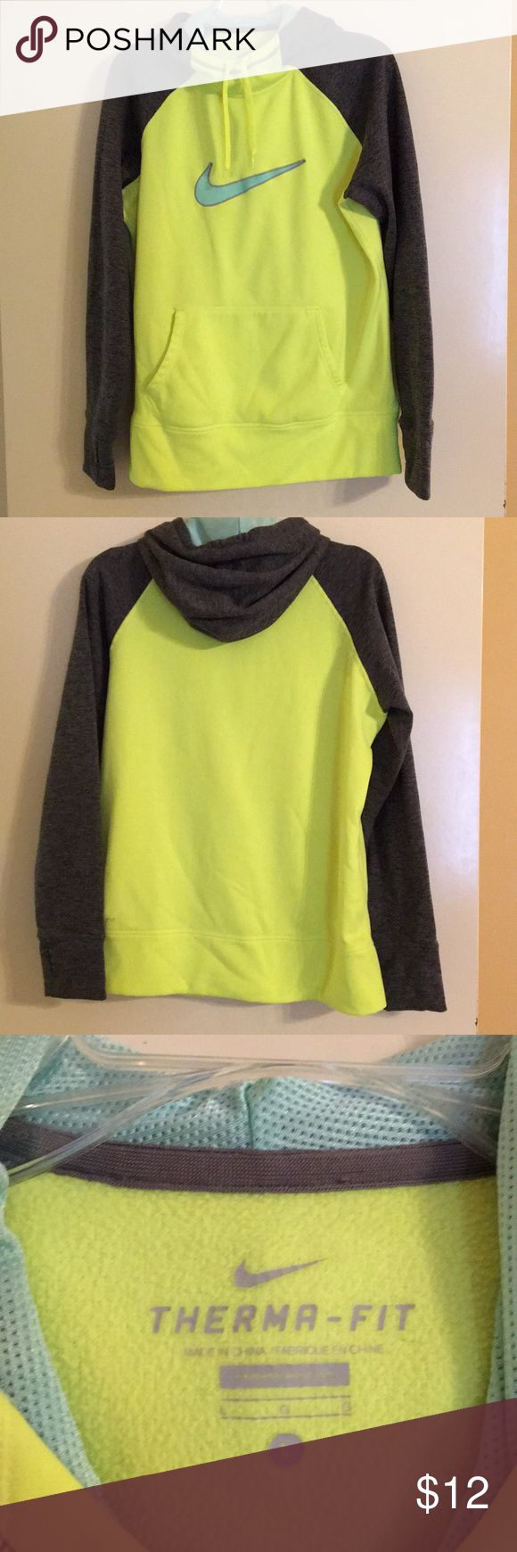 Nike Therma-Fit Women's Hoodie Large Nike Therma-Fit Hoodie.  Color is neon yellow with heather grey sleeves and aqua blue swoosh. Women's large.  There are a few small stains that I tried to show in the last pics.  They are pretty faint and not too noticeable.  Great condition other than that! Nike Tops Sweatshirts & Hoodies
