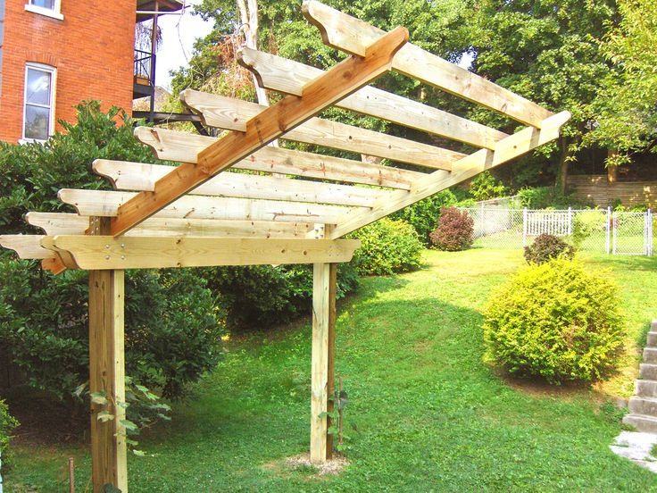 Cantilevered pergola step 5 front pergolas carport for Carport landscaping ideas