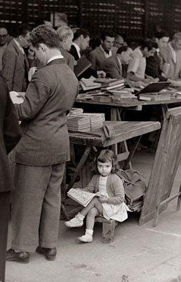 little girl reading at a book sale? For more book fun, follow us on Pinterest & Facebook. www.facebook.com/booktasticfun