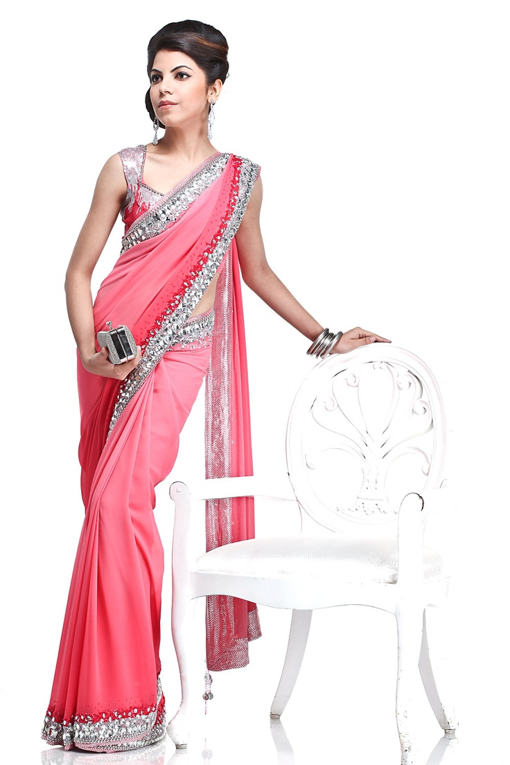 Satya Paul  A beautiful omber dyed georgette sari with a 9 yard border accentuated with the use of sequins and stones, comes with a classy crepe-de-chine blouse with embroidery at the neck line and sleeves. A perfect occasion wear ensemble.