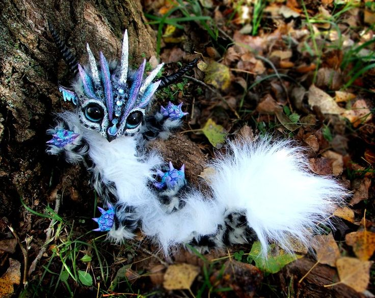 Who says magical creatures don't exist?  (Posable Baby Snow Leopard Dragon by *Wood-Splitter-Lee)