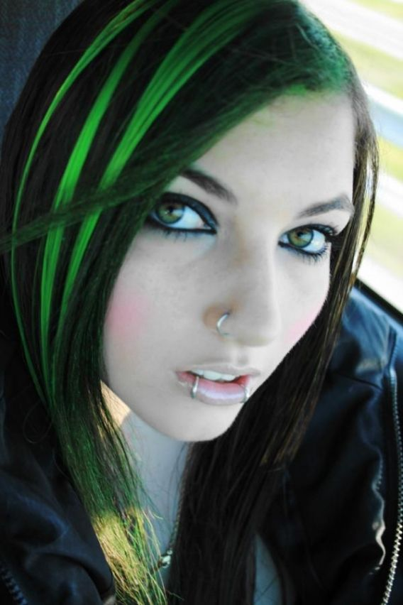 Black hair with neon highlights is a great idea for those who want to have  dramatic look. Neon colors are bright colors such as green, blue, and pink.