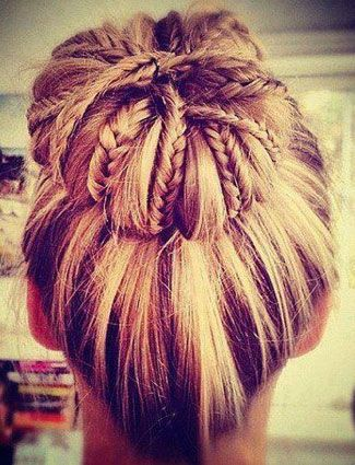 This style incorporates two trends — a sock bun and braids — into one perfect summer look. Secure hair into a ponytail and randomly braid small sections. Then, roll your hair into a sock bun and the braids will show through.