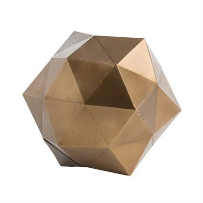 To create the pentagon patterns and star-like shape, artisans start with lightweight sheets of metal scored into triangles, then fold them like paper and weld them together. The final sculpture is then hand finished in antique brass.