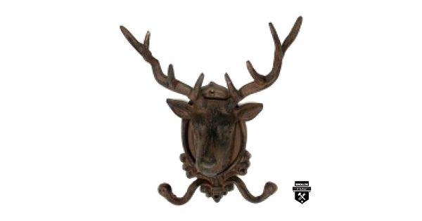 """Crochet chevreuil d1459Crochet double tête de chevreuilCrochet en fonte patinée brun antique.En forme de chevreuil, il donne à votrepièce un esprit campagneFonte.Brun rouille.10 1/2""""H x 4""""P x 9""""LVis incluses"""