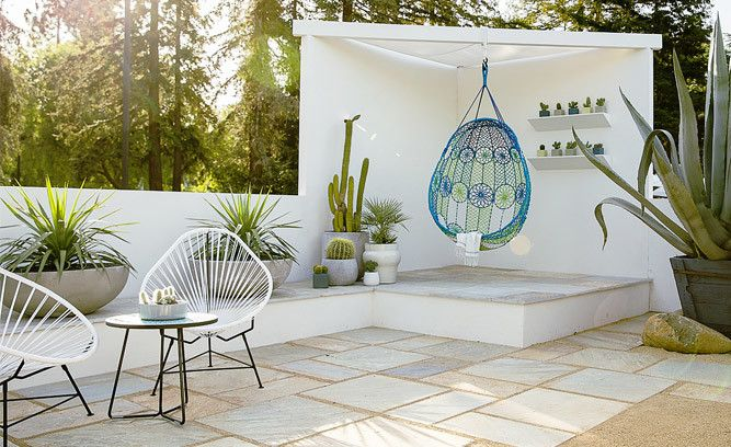 Drought-resistant gardens can be just as chic as their water-loving counterparts. This desert oasis features an assortment of low-water plants along with Bohemian-style seating, creating a casual space to unwind and end the day. Click to recreate this look with our editors' design tips.