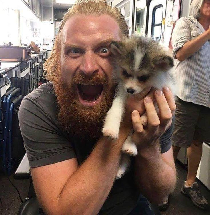 Tormund with a direwolf pup.