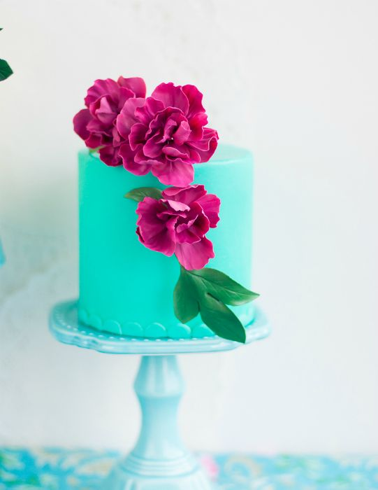 Turquoise cake with flowers.