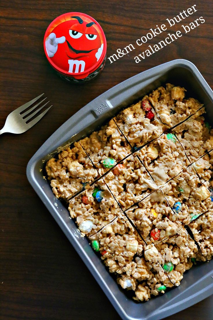 These No-Bake M&M'S® Cookie Butter Avalanche Bars are a spin-off of my friends' absolute FAVORITE avalanche cookie. They take only 5 minutes to make and taste incredible! Fluffy marshmallows, crispy rice cereal, cinnamony cookie butter, and crunchy chocolate candies make this the perfect portable treat! #MakeItAMovieNight #ad