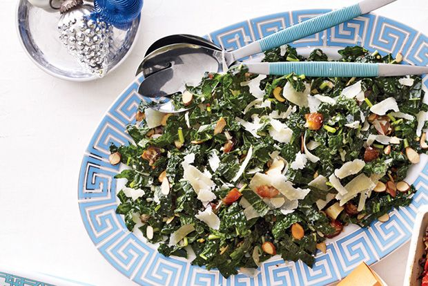 Kale Salad with Dates, Parmesan and Almonds. Absolutely delish!  But made it with craisins vs dates.