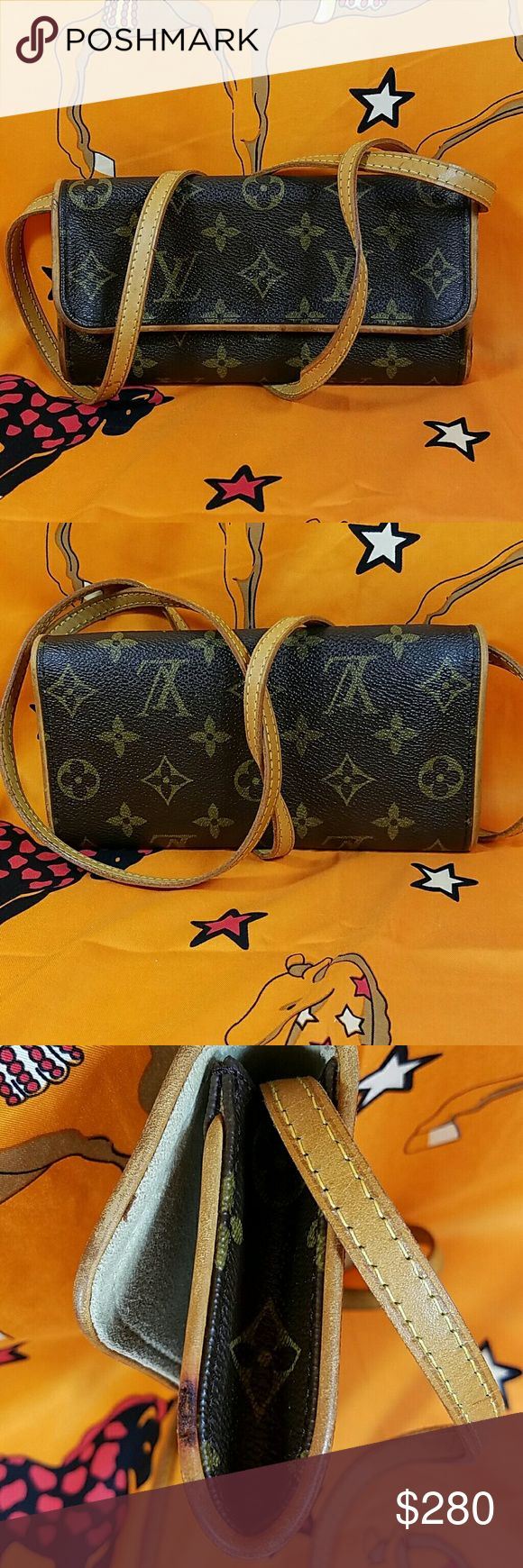 "Authentic Louis Vuitton Monogram Twin Pochette The canvas is in good condition. The leather trims showed wearing, 2 cracks ( 3rd, 4th pictures), some dark spots on the leather trims also. About 48"" long strap is in good condition. Date code CA0091. It made in Spain. Dimension: ( about) 4, 7, & .5. No trade please. Louis Vuitton Bags Shoulder Bags"