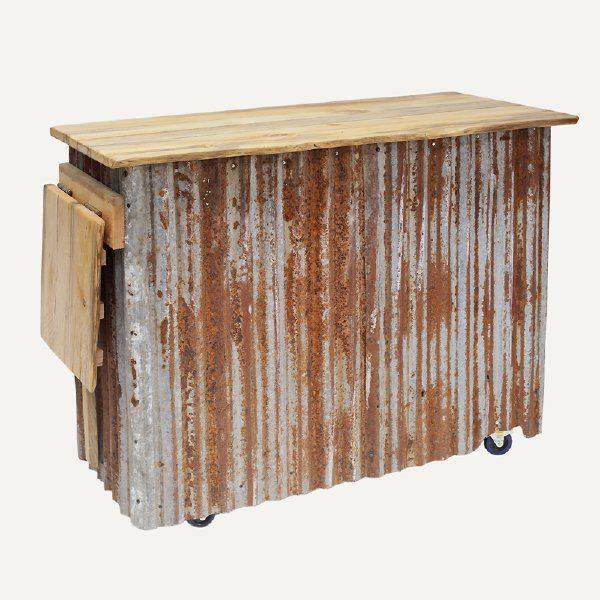 """This rustic-industrial portable bar is the perfect piece to serve your guests in style. Features corrugated metal front and sides, rustic wood plank top and open back with two shelves. Has an 18"""" fold-up side table for additional counter space and locking wheels for easier moving."""